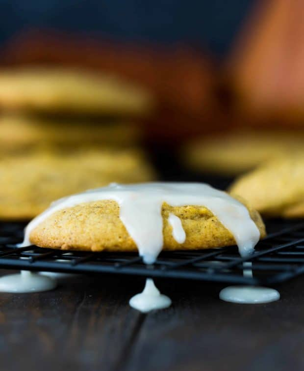 Pumpkin cookie topped with a powdered sugar glaze.