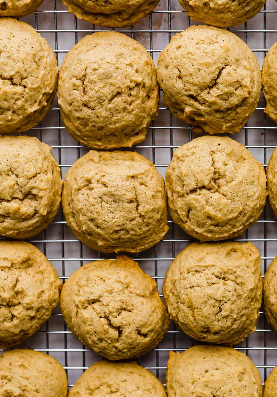 Baked pumpkin cookies on a cooling rack.