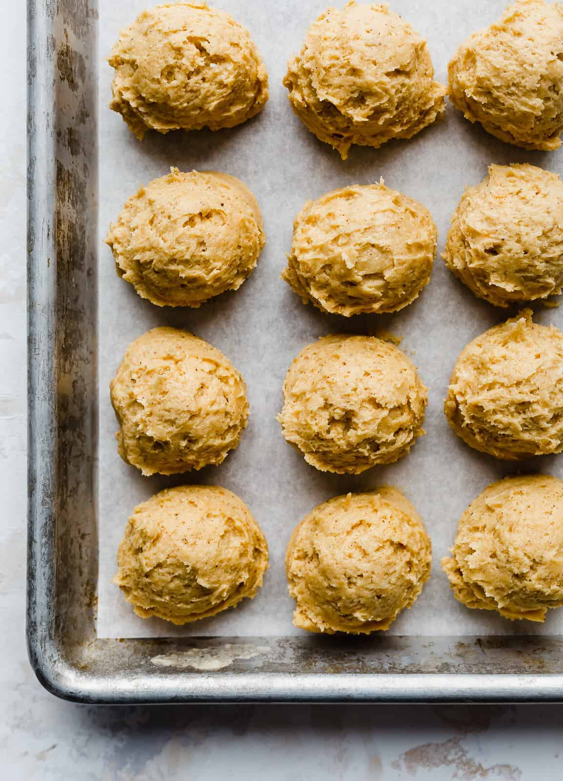 pumpkin dough balls on a baking sheet.