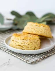 Two buttermilk biscuits sitting on a small plate.