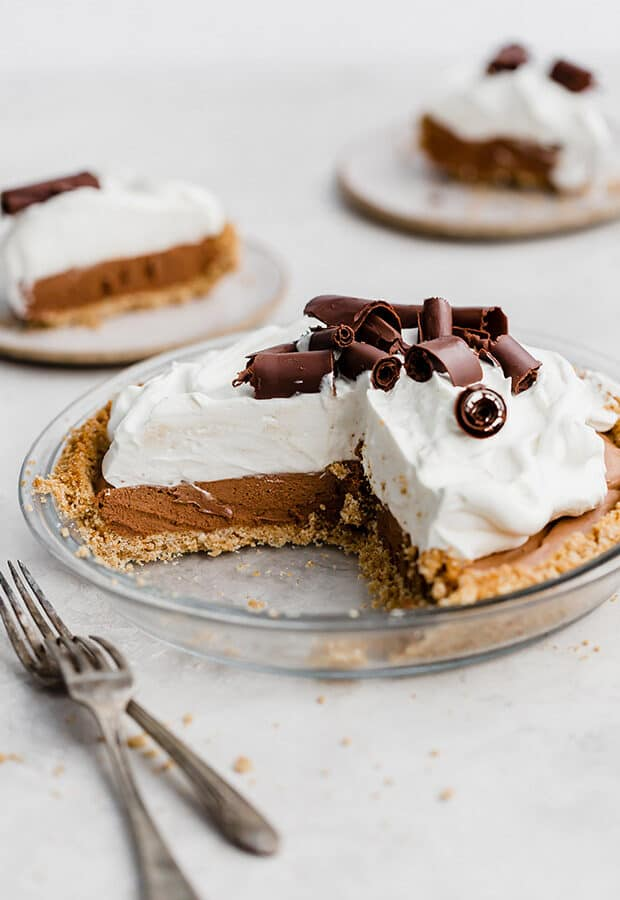 A French silk pie with several slices removed, showcasing the creamy chocolate interior.