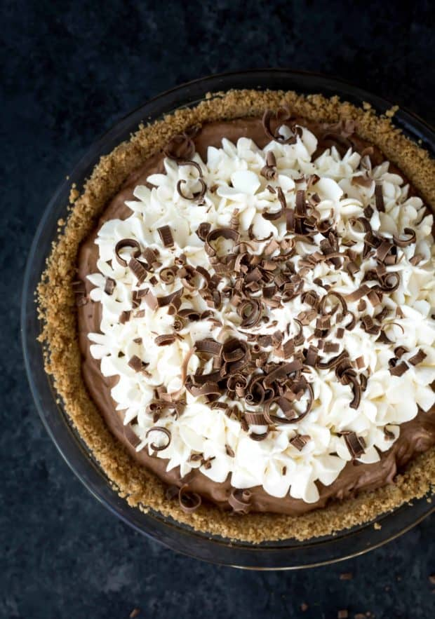 French Silk Chocolate Pie with whipped cream and chocolate curls.