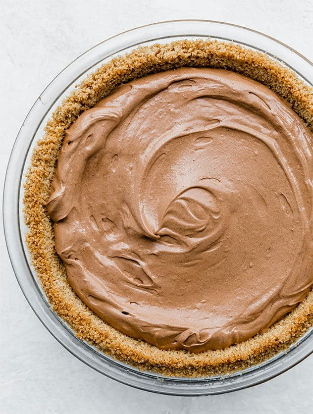 A graham cracker crust with billowy French silk pie filling in the crust.