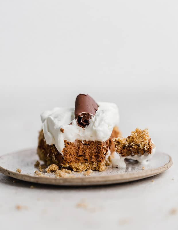 A slice of French silk pie, with a fork next to it.
