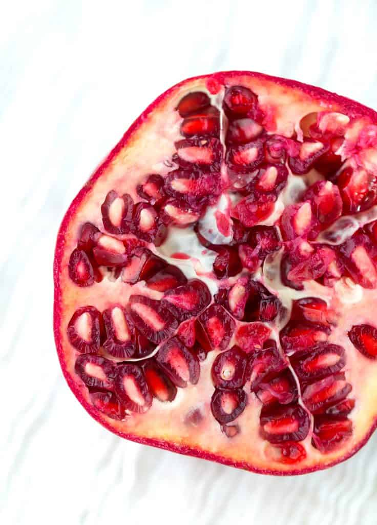 Close up of a pomegranate cut in half.