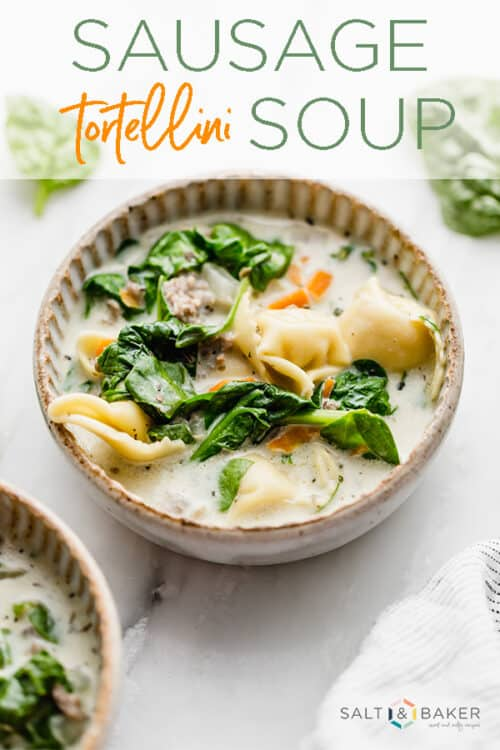 A bowl full of delicious sausage and tortellini soup.