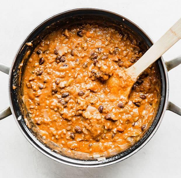 A large pot full of Mexican Lasagna filling.