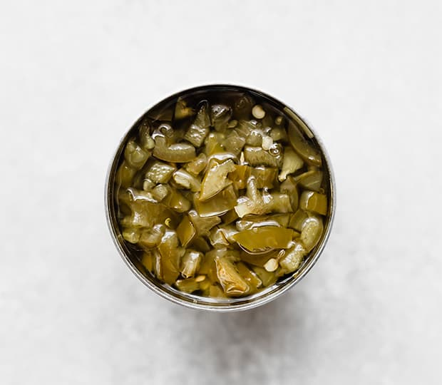 An overhead photo of an opened can of canned jalapeños.