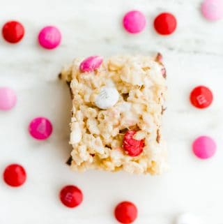 Square Rice Krispie treat made with pink, red, and white M&M's.