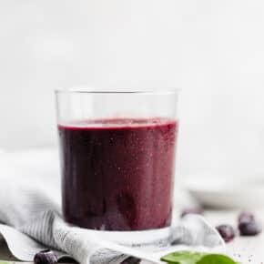 A clear glass full of healthy Açaí Smoothie.