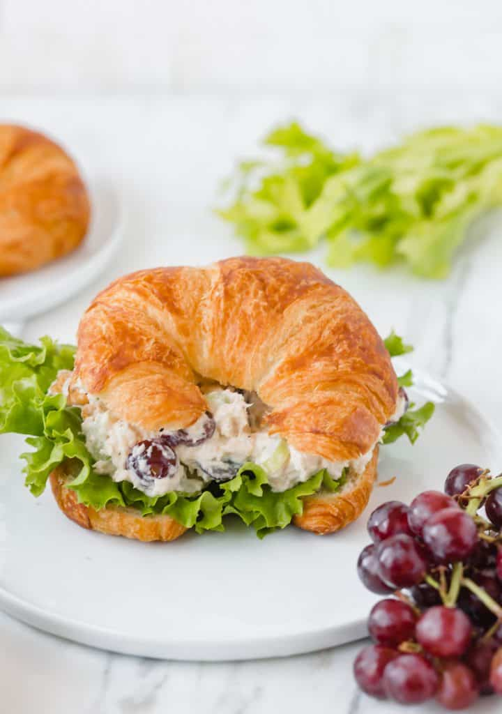 The perfect Chicken Salad Sandwich recipe! This sandwich is loaded with grapes, celery, chicken, cashews, and mayo!
