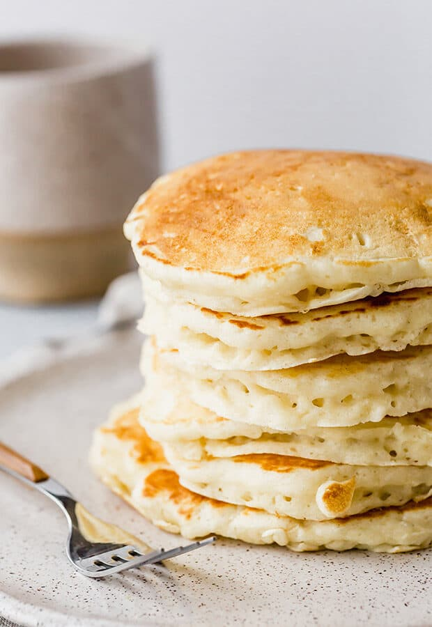 A stack of fluffy homemade pancakes.