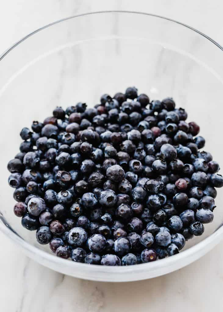 A bowl of fresh blueberries in preparation to make blueberry crisp.