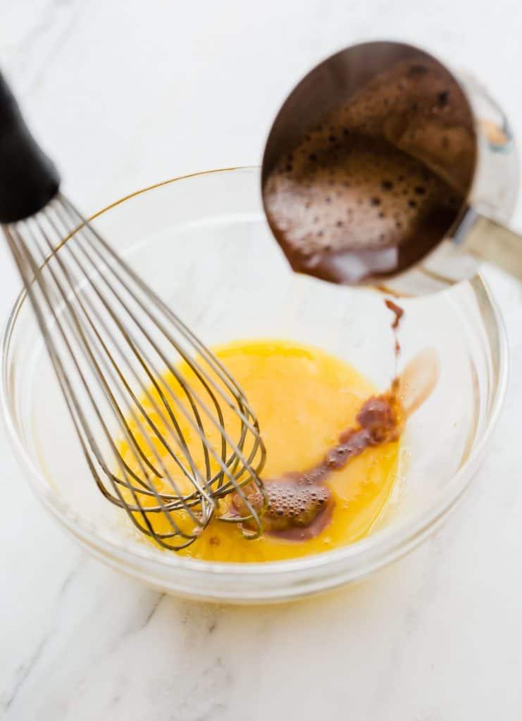 Tempering egg yolks for homemade chocolate ice cream.