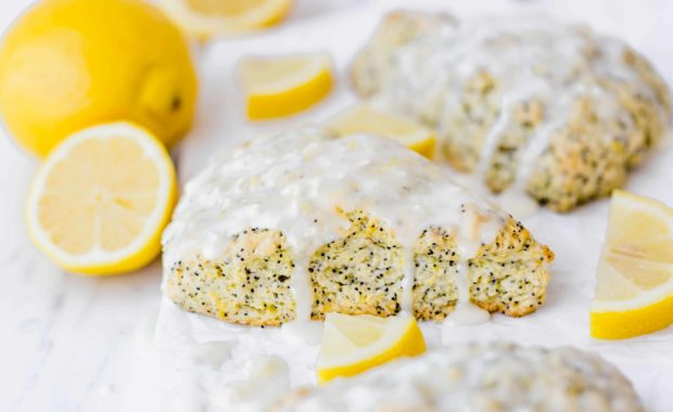 These Lemon Poppy Seed Scones are the perfect spring and summer treat! They are loaded with the perfect lemon flavor and topped with an irresistible glaze!