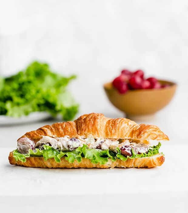A croissant filled with chicken salad.
