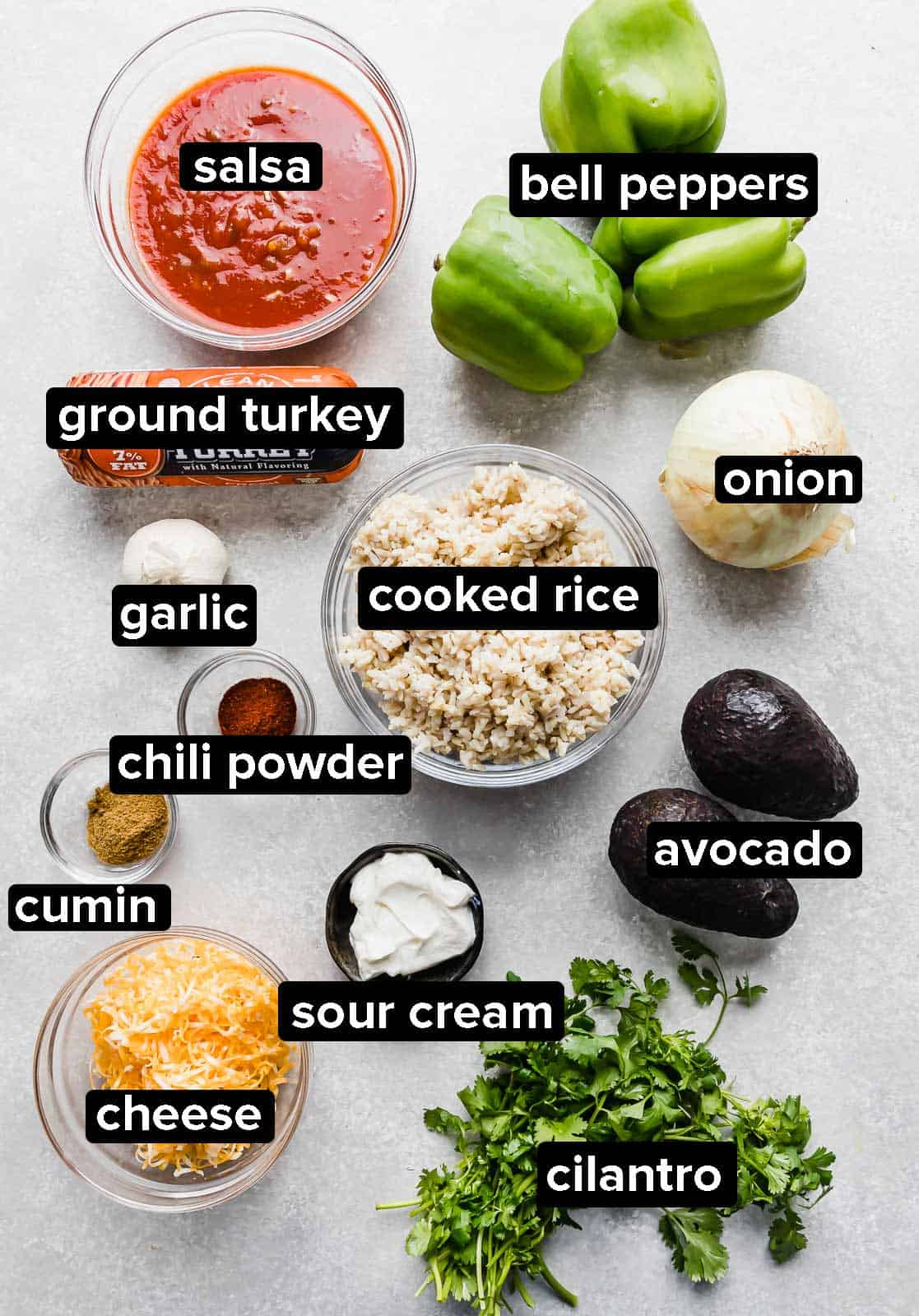 Ingredients used to make Deconstructed Stuffed Peppers on a gray background.