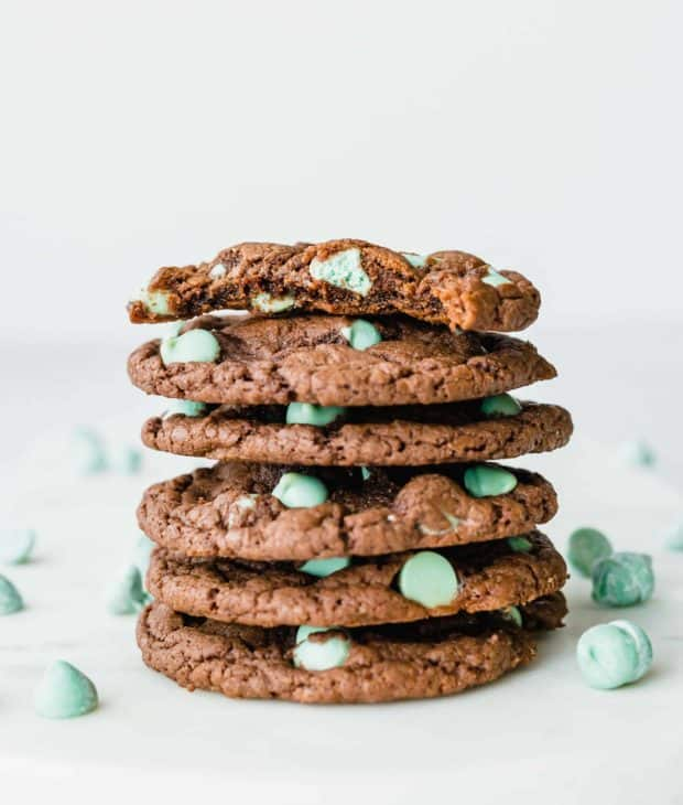 Six Devil's food cake box mix cookies studded with mint chips, stacked on top of each other.