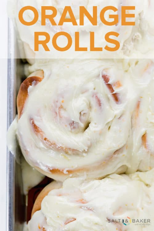 Close up photo of orange rolls with thick frosting.