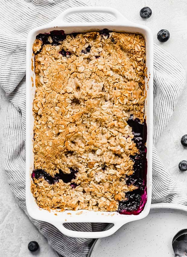 Golden brown crumble topped blueberry crisp.