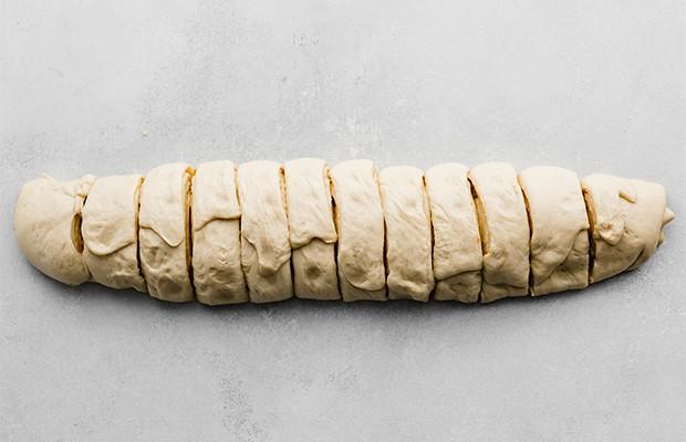 Twelve slices of orange rolls.