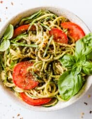 This 5-Minute Cheesy Zucchetti Bowl from Cotter Crunch's new cookbook is an easy zucchini noodles recipe that you'll make again and again! This meal is gluten free and low carb too!