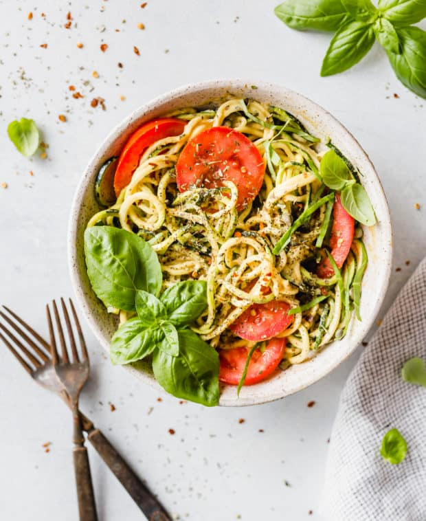 Zucchini noodles are used to make this 5-Minute Cheesy Zucchetti Bowl! Topped with bright red tomatoes, fresh basil, and Italian seasoning this dish is delicious!