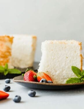 An easy to make Angel Food Cake Recipe that's soft, fluffy, and rich in flavor! Add fruit and whipped cream and you've just made the perfect dessert!