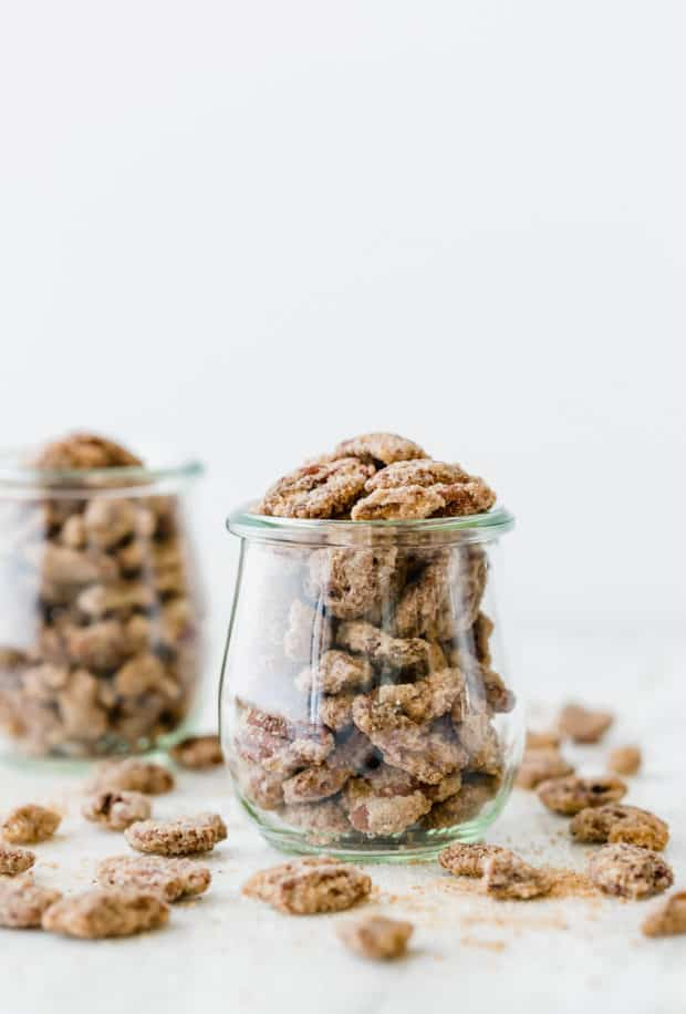 Candied pecans overflowing 2 glass jars