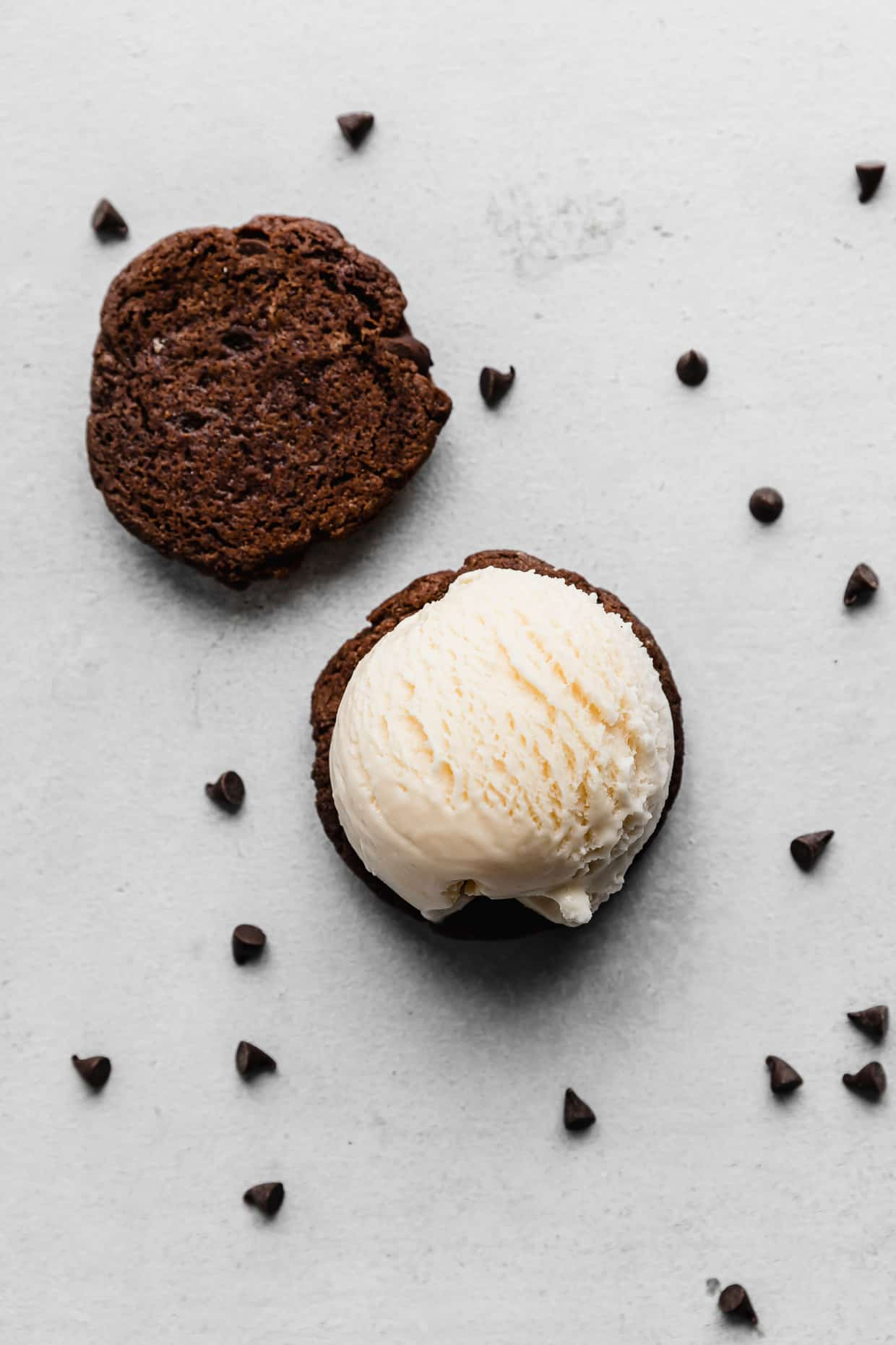 Overhead photo of a scoop of vanilla ice cream on a chocolate cookie.