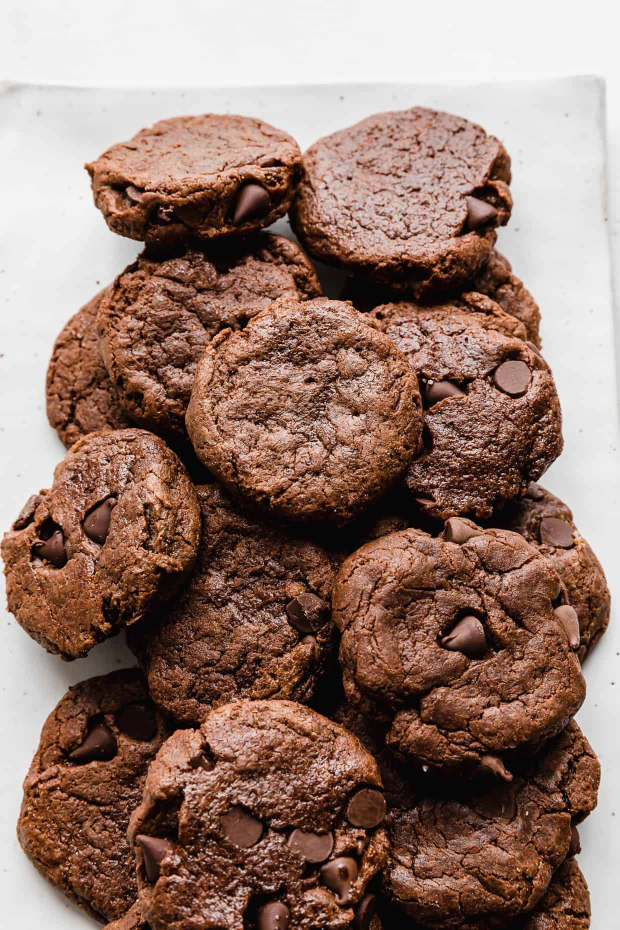 A plate of chocolate cookies on a white background.