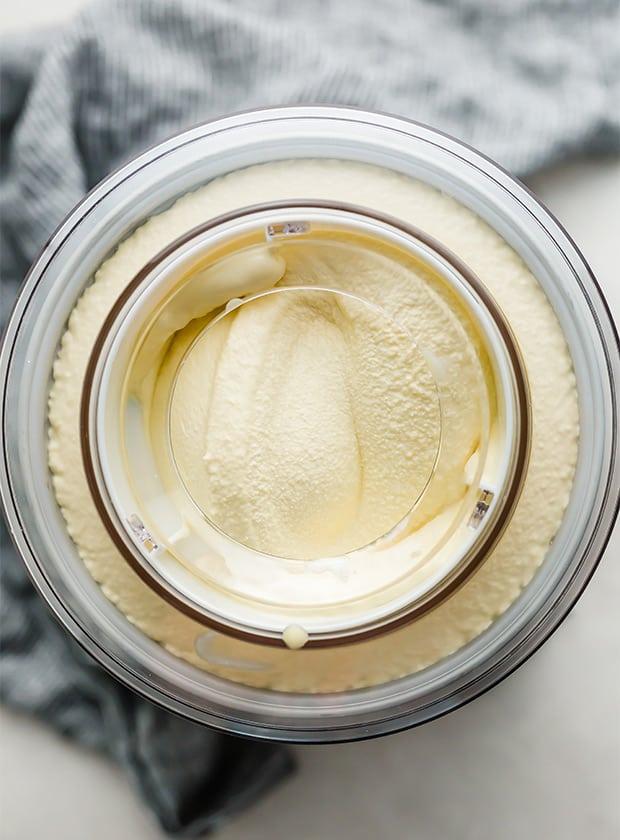 Homemade Vanilla Ice Cream being churned in an ice cream machine.