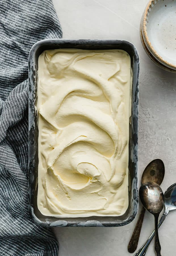 A bread pan full of homemade vanilla ice cream.