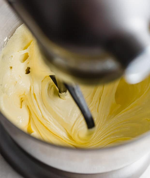 A stand mixer beating the sugar and egg yolks until creamy.