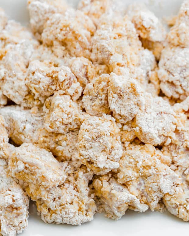 Bite size pieces of chicken dredged in the cornstarch and flour breaded mixture.