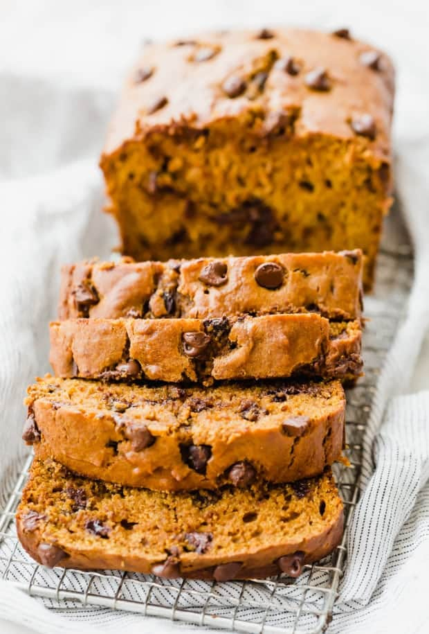 Pumpkin chocolate chip bread with 4 cut slices.