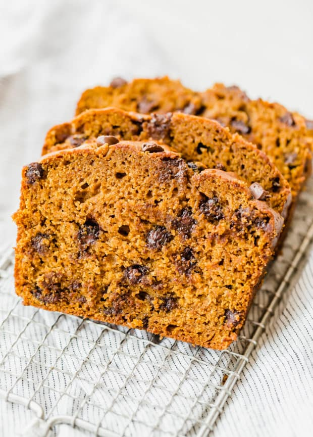 Slice of pumpkin chocolate chip bread, chocolate chips perfectly dispersed throughout.