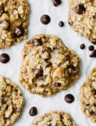 Oatmeal Chocolate Chip Cookies on a white parchment paper.