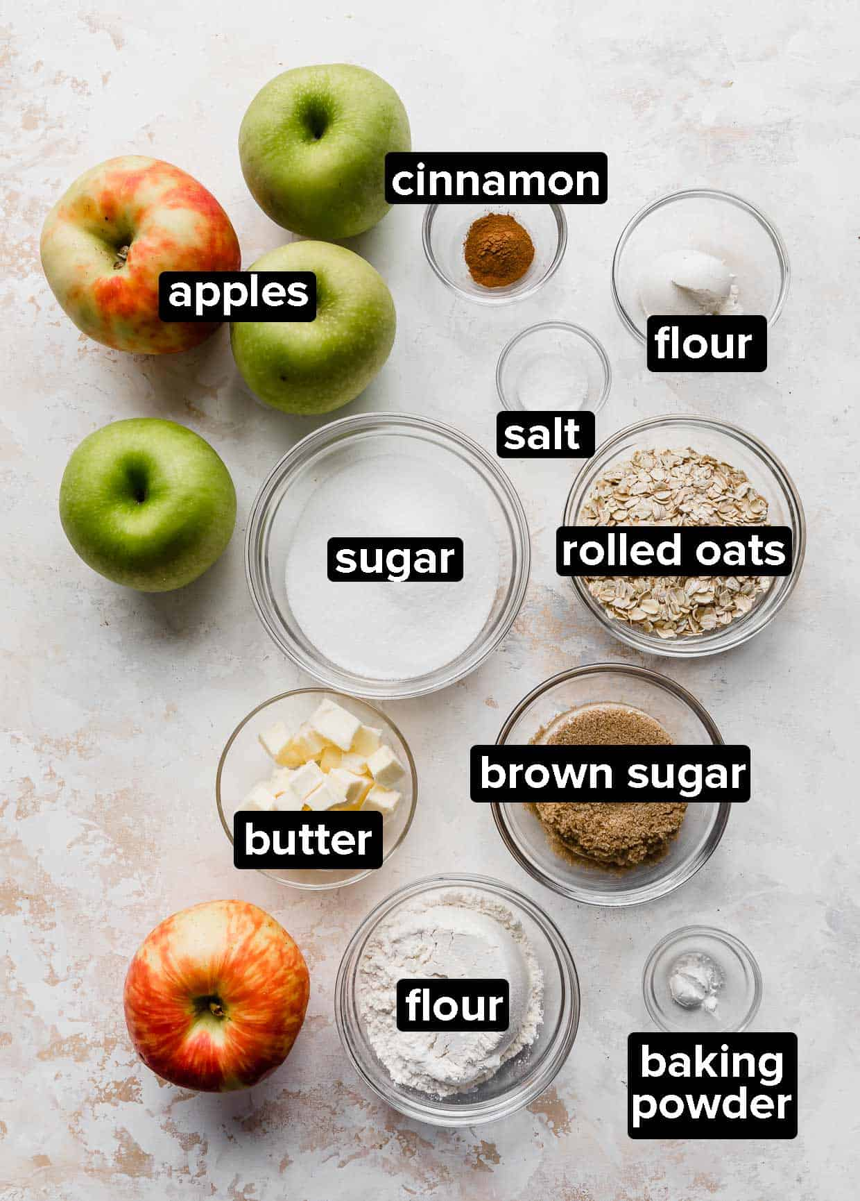Easy Apple Crisp ingredients on a textured white background.