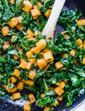 Diced butternut squash and chopped kale seasoned with pepper and chili powder.