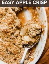 A serving spoon scooping out apple crisp.