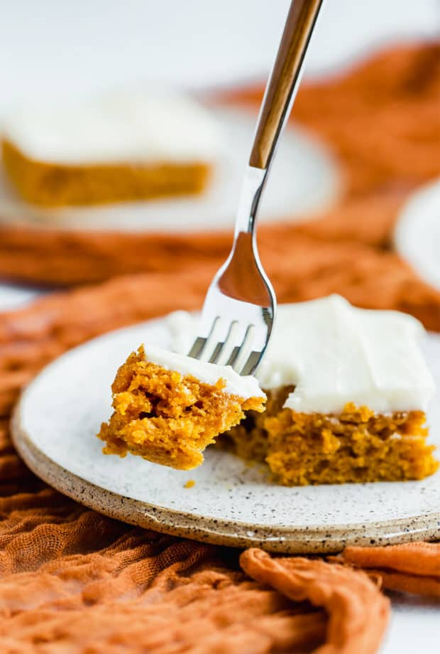 A bite of pumpkin bars on a fork.