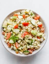Overhead photo of Feta Corn Salad in a large bowl.
