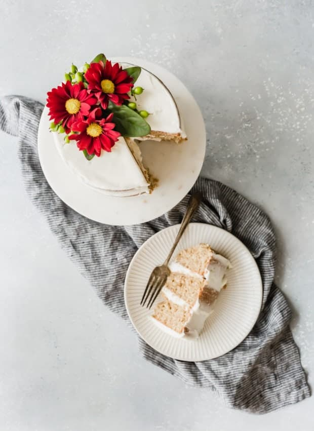 Overhead photo of a layered spice cake and a slice cut out of the cake.