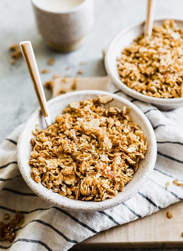 Brown granola in a handmade ceramic bowl. - holiday breakfasts you can make ahead