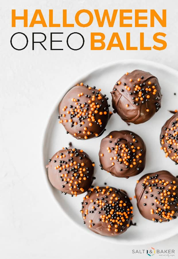 Oreo balls dipped in dark chocolate and covered in orange and black sprinkles.