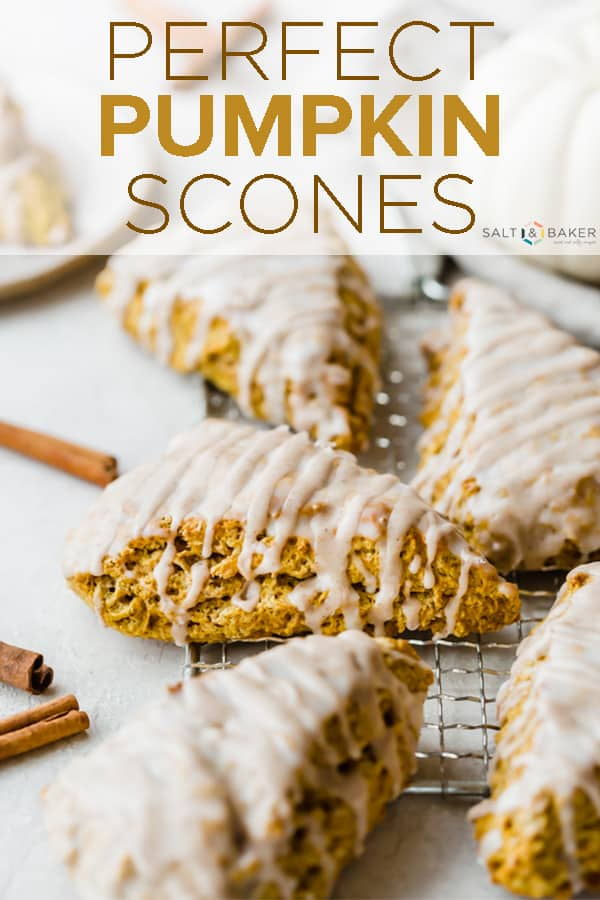 These Pumpkin Scones have a warm array of spices AND they're topped with two irresistible glazes. This is a perfect copycat version of Starbucks' pumpkin scones. #saltandbaker #pumpkin #pumpkinscones #Starbucks