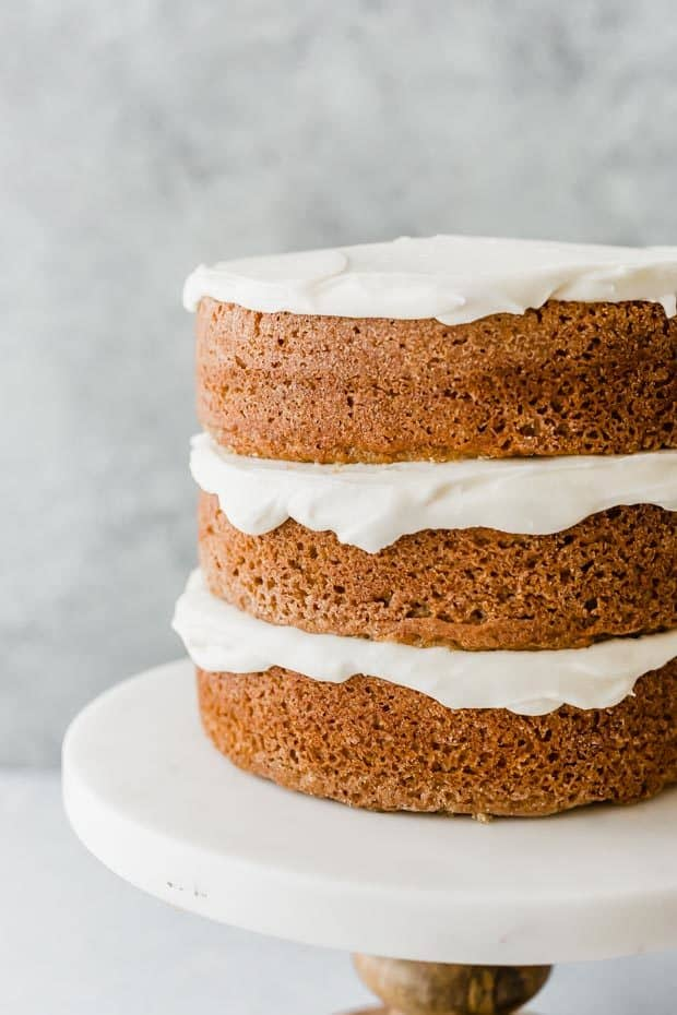 Three layers of baked spice cake with cream cheese frosting between each layer.