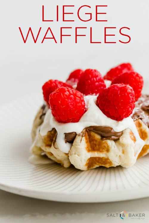 Belgian liege waffle topped with Nutella, whipped cream, and raspberries.