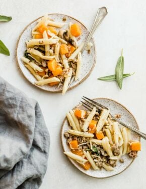 Two plates with the butternut squash pasta on each plate, with a fork along the side.